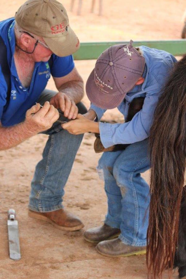 Blog 1 Photo 2 Jack Towne learning how to shoe a horse. 2