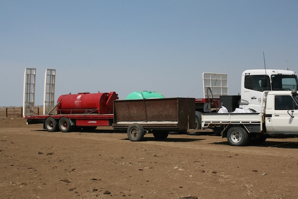 5.7 - Molasses mixer on truck + cottonseed trailer
